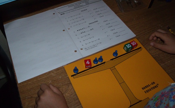 student using Hands-On Equations program